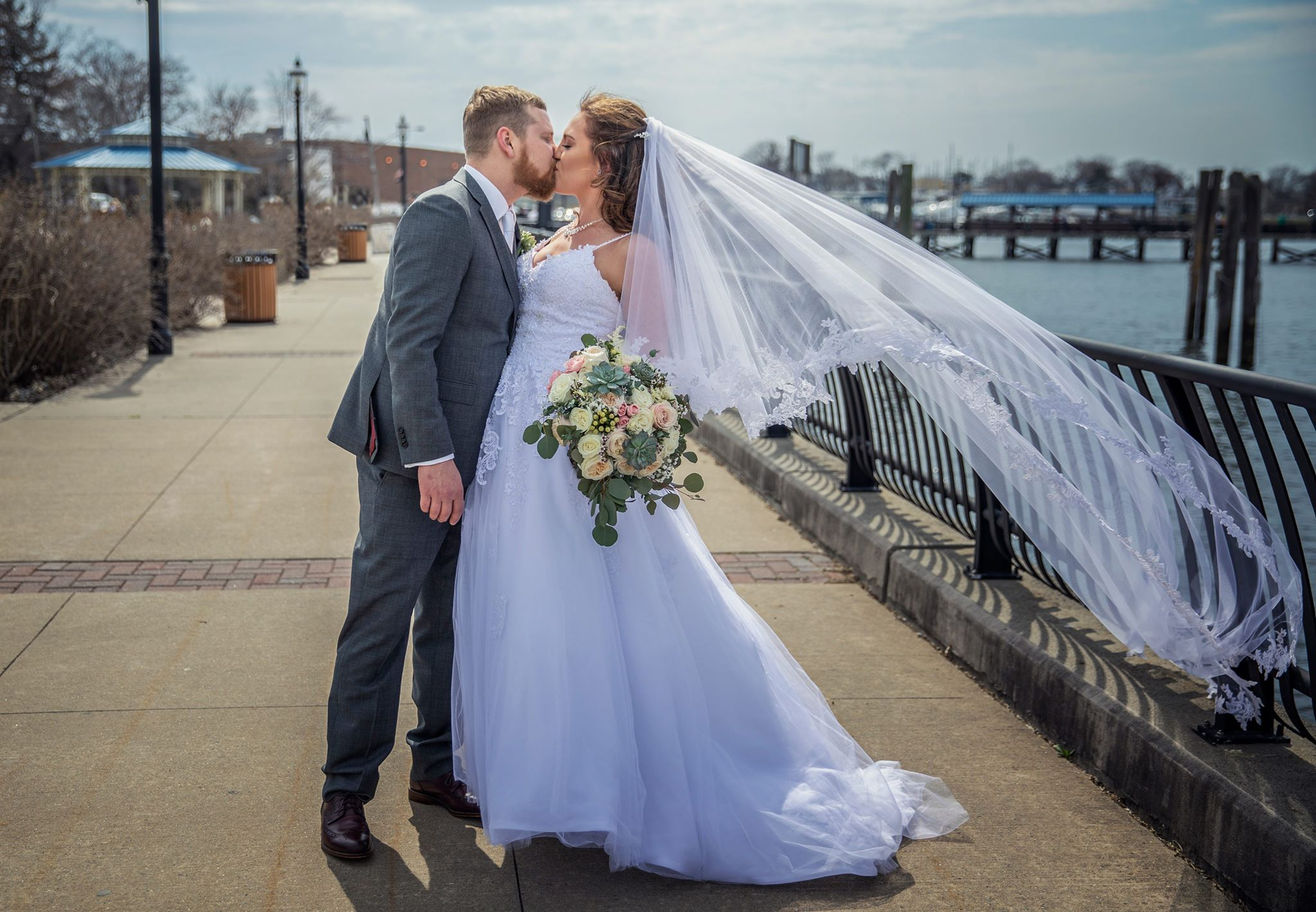 Bride and Groom Kissing in Ocean Front Walkway